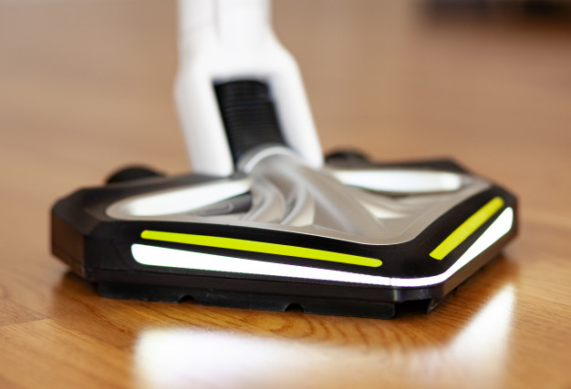 image of hardwood floor cleaning with vacuum cleaner for the best hardwood floor vacuums reviews & buying guide